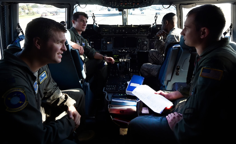 U.S. Air Force reservists and active-duty members conduct prelaunch checks for a C-17 Globemaster III here, prior to departing for Joint Base Lewis-McChord, Washington State, in support of Exercise Mobility Guardian July 31. Mobility Guardian is designed to enhance the capabilities of mobility Airmen to succeed in dynamic threat environments. The exercise features more than 3,000 participants and involves 25 countries from July 31 to Aug. 11. (U.S. Air Force photo by Staff Sgt. Christopher Hubenthal)
