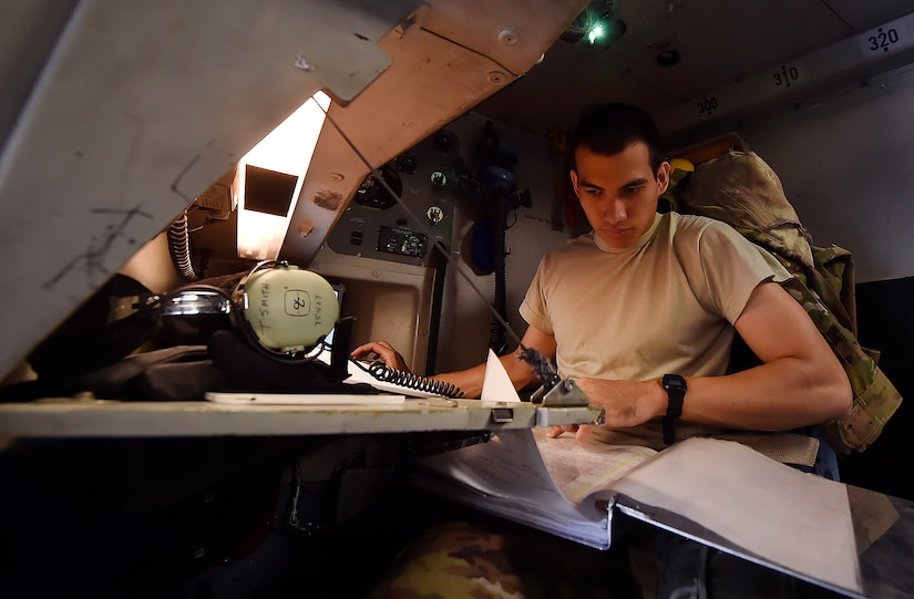 Senior Airman Raymond Salas, 15th Airlift Squadron C-17 Globemaster III loadmaster, conducts prelaunch checks for a C-17 here, prior to departing for Joint Base Lewis-McChord, Washington State, in support of Exercise Mobility Guardian July 31. Mobility Guardian is designed to enhance the capabilities of mobility Airmen to succeed in dynamic threat environments. The exercise features more than 3,000 participants and involves 25 countries from July 31 to Aug. 11. (U.S. Air Force photo by Staff Sgt. Christopher Hubenthal)