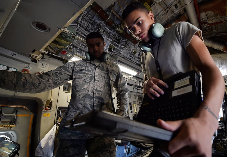 Airman 1st Class Jamar Finnie, right, 437th Aircraft Maintenance Squadron instrument and flight control systems apprentice and Tech. Sgt. Timothy Smith, 437th AMXS, conduct prelaunch checks for a C-17 Globemaster III here, prior to departing for Joint Base Lewis-McChord, Washington State, in support of Exercise Mobility Guardian July 31. Mobility Guardian is designed to enhance the capabilities of mobility Airmen to succeed in dynamic threat environments. The exercise features more than 3,000 participants and involves 25 countries from July 31 to Aug. 11. (U.S. Air Force photo by Staff Sgt. Christopher Hubenthal)