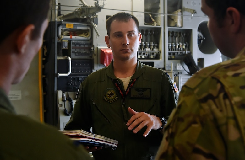 Capt. Brian Guiney, 16th Airlift Squadron C-17 Globemaster III pilot, briefs aircrew members here, prior to departing for Joint Base Lewis-McChord, Washington State, in support of Exercise Mobility Guardian July 31. Mobility Guardian is designed to enhance the capabilities of mobility Airmen to succeed in dynamic threat environments. The exercise features more than 3,000 participants and involves 25 countries from July 31 to Aug. 11. (U.S. Air Force photo by Staff Sgt. Christopher Hubenthal)
