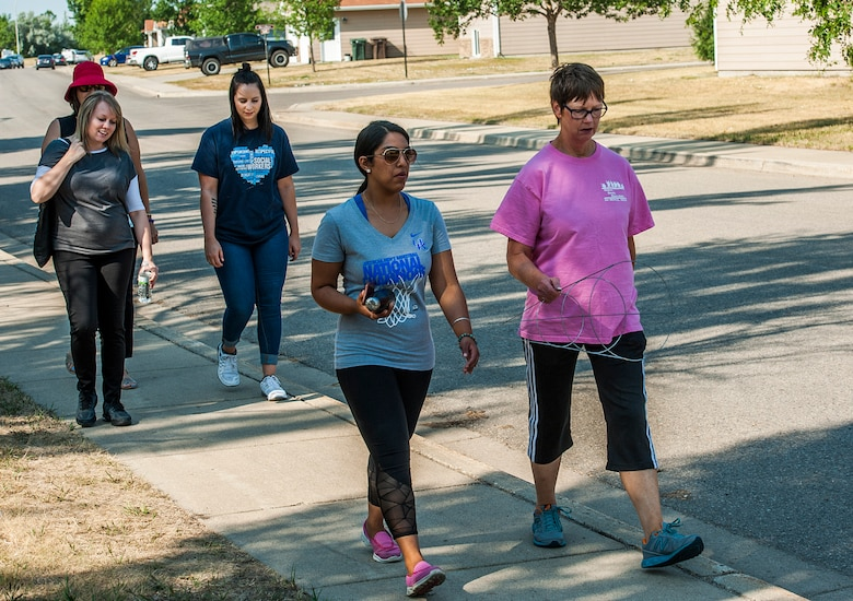 Members of Team Minot participate in the Minot Monday Community Walks at Minot Air Force Base, N.D., July 23, 2017. These walks last from 45 minutes to an hour and are used to promote health and wellness in the base community. (U.S. Air Force photo by Airman 1st Class Jonathan McElderry)