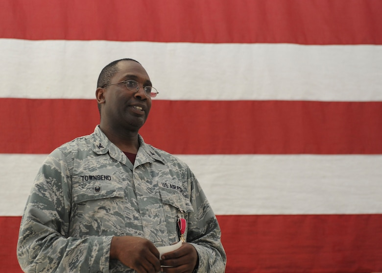 Col. Kelvin Townsend, 91st Missile Wing vice commander, speaks at his going-away ceremony at Minot Air Force Base, N.D., July 14, 2017. After three separate tours to Minot AFB, Townsend's next assignment is at Barksdale AFB, Louisiana. (U.S. Air Force photo by Airman 1st Class Jessica Weissman)