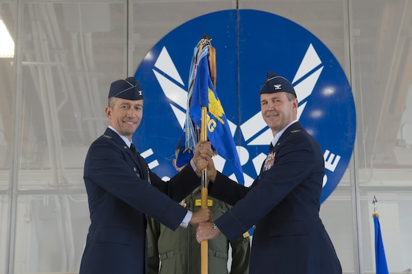 Col. Houston Cantwell, 49th Wing commander, gives the 49th Operations Group guidon to Col. Jeffery Patton during a change of command ceremony at Holloman Air Force Base, N.M., July 31, 2017. During the ceremony, Col. Patton took command of the 49th OG from Col. Ryan Sherwood, 49th OG outgoing commander. (U.S. Air Force photo by Tech. Sgt. Amanda Junk)