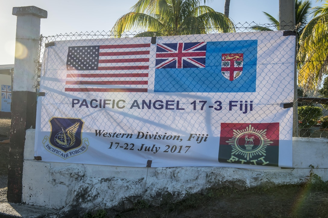 The Pacific Angel (PACANGEL) 17-3 banner sign waves in the wind as the sunsets at the Tagitagi Sangam School and Kindergarten in Tavua, Fiji, July 22, 2017. PACANGEL 17-3 built partnerships between the U.S., Fiji, and five regional nations including Australia, Vanuatu, Indonesia, the Philippines and France by conducting multilateral humanitarian assistance and civil military operations, promoting regional military-civilian-nongovernmental organization cooperation and interoperability. (U.S. Air Force photo/Tech. Sgt. Benjamin W. Stratton)
