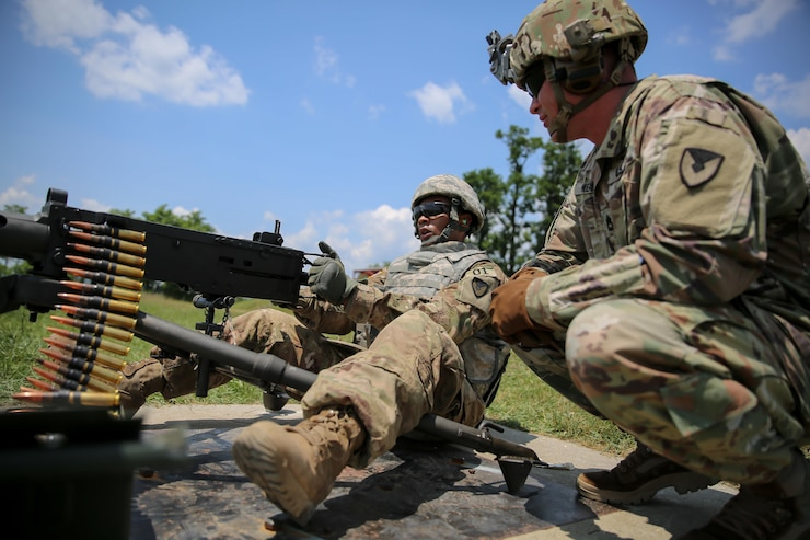 U.S. Army Staff Sgt. Qujuan Baptiste fires an M2 .50 caliber machine gun during the 2017 Army Materiel Command's Best Warrior Competition July 18, 2017, at a range in Camp Atterbury, Indiana. During the three-day competition, these elite warriors are test on basic and advanced warrior tasks and drills. Baptiste is assigned to the Army Sustainment Command. (U.S. Army photo by Sgt. 1st Class Teddy Wade)