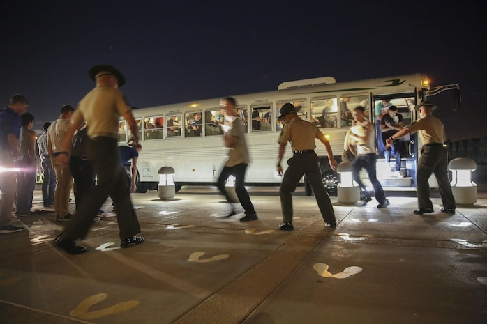 New recruits of Delta Company, 1st Recruit Training Battalion, are welcomed to the depot as they exit the bus and step onto the yellow footprints during receiving at Marine Corps Recruit Depot San Diego, July 24. From this point on, recruits will eat, sleep and train as a team as they begin the transformation from civilian to Marine. Annually, more than 17,000 males recruited from the Western Recruiting Region are trained at MCRD San Diego. Delta Company is scheduled to graduate Oct. 20.
