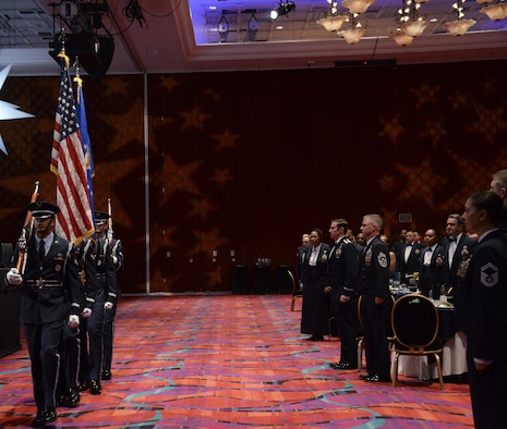 The Honor Guard from Travis Air Force Base, Calif., present the colors at the Air Force Sergeants Association International Convention in Reno, Nevada. This signified the beginning of the Air Force Honors Banquet, which was the final event for the Professional Airmen's Conference. (U.S. Air Force photo by Senior Airman Amber Carter)