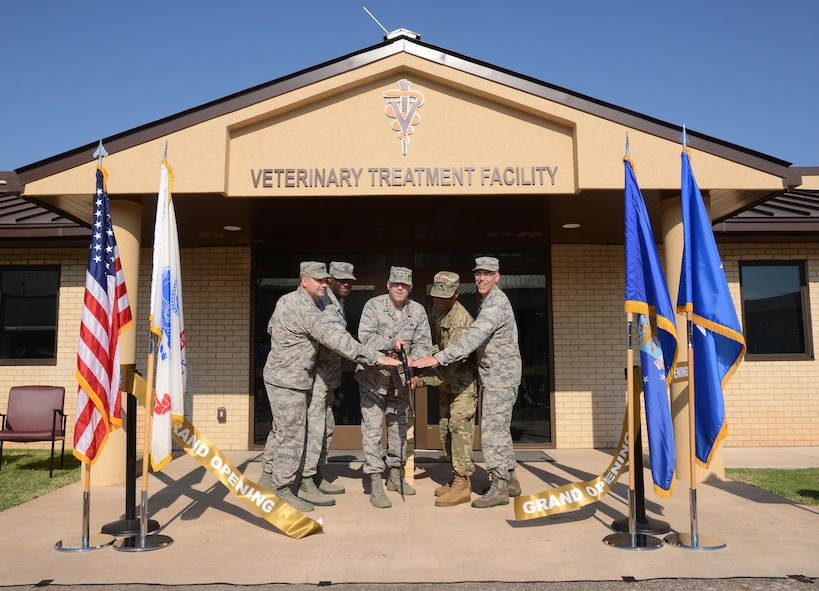 From left, 72nd Medical Support Squadron Commander Lt. Col. Jeffrey Fewell, 72nd Air Base Wing Commander Col. Kenyon Bell, Air Force Sustainment Center Commander Lt. Gen. Lee K. Levy II, Public Health Activity Commander at Fort Hood Lt. Col. Sydney Cobb and 72nd Medical Group Commander Col. Christopher Grussendorf cut the ceremonial ribbon at the newly remodeled Veterinary Treatment Facility on the south side of Tinker July 17, 2017. As a joint partnership between the U.S. Army Medical Department's Veterinary Corps and the AFSC, 72nd ABW, 72nd MDG, 72nd Force Support Squadron and 72nd Security Forces Squadron, the clinic has increased its capabilities of care to further support Military Working Dogs as well as family pets for military members and retirees. (Air Force photo by Kelly White)