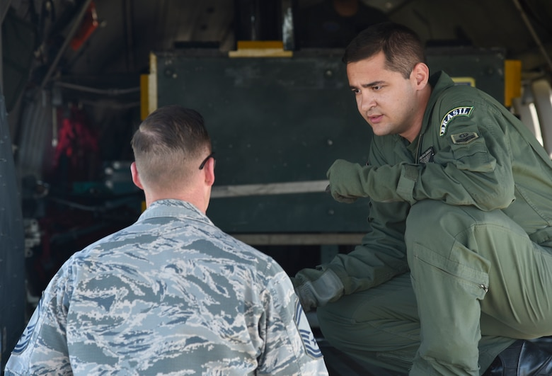 Senior Master Sgt. Joseph Wallis, 62nd Aircraft Maintenance Squadron lead production superintendent, talks with a member of the Brazilian air force's 5th Wing at Joint Base Lewis-McChord, Wash., July 29, 2017. More than 3,000 Airmen, Soldiers, Sailors, Marines and international partners converged on the state of Washington in support of Mobility Guardian. The exercise is intended to test the abilities of the Mobility Air Forces to execute rapid global mobility missions in dynamic, contested environments. Mobility Guardian is Air Mobility Command's premier exercise, providing an opportunity for the Mobility Air Forces to train with joint and international partners in airlift, air refueling, aeromedical evacuation and mobility support. (U.S. Air Force photo by Airman 1st Class Erin McClellan)