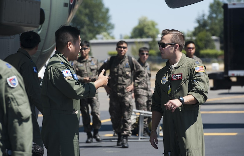 Capt. Mark Bishop, KC-10 Extender aircraft commander and international relations team member, greets members from the 251 Squadron, 5th Air Mobility Wing, Gimhae Airbase, Busan, Republic of Korea, following their arrival to Mobility Guardian, Joint Base Lewis-McChord, Wash., July 29, 2017. Crew members from 251 Squadron, 5th Fighter Wing, Gimhae Air Base, Busan, South Korea, wait to secure their aircraft propellers following their arrival to Mobility Guardian, Joint Base Lewis-McChord, July 9, 2017. More than 3,000 Airmen, Soldiers, Sailors, Marines and international partners converged on the state of Washington in support of Mobility Guardian. The exercise is intended to test the abilities of the Mobility Air Forces to execute rapid global mobility missions in dynamic, contested environments. Mobility Guardian is Air Mobility Command's premier exercise, providing an opportunity for the Mobility Air Forces to train with joint and international partners in airlift, air refueling, aeromedical evacuation and mobility support. Capt. Bishop is currently stationed at Joint Base McGuire-Dix-Lakehrust, N.J., and hails fom Grand Rapids, M.I. (U.S. Air Force photo by Senior Airman Lauren Russell)