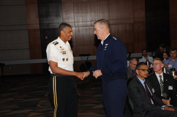 U.S. Army Gen. Vincent K. Brooks (left), commander of U.S. Forces Korea, United Nations Command and Republic of Korea-U.S. Combined Forces Command, is thanked by U.S. Air Force Gen. John. E. Hyten, commander of U.S. Strategic Command (USSTRATCOM), during USSTRATCOM's annual Deterrence Symposium at the CenturyLink Center, Omaha, Neb., July 26, 2017. During the two-day symposium, industry, military, governmental, international and academic experts discussed and promoted increased collaboration to address 21st century strategic deterrence.  One of nine Department of Defense unified combatant commands, USSTRATCOM has global strategic missions assigned through the Unified Command Plan that include strategic deterrence, space operations, cyberspace operations, joint electronic warfare, global strike, missile defense, intelligence, and analysis and targeting.