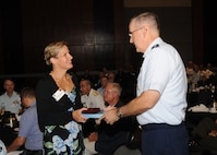 Isabelle Desmartis, Canadian Department of National Defence director general of policy planning, receives a momento from U.S. Air Force Gen. John. E. Hyten, commander of U.S. Strategic Command (USSTRATCOM), following a presentation during USSTRATCOM's annual Deterrence Symposium at the CenturyLink Center, Omaha, Neb., July 27, 2017. Desmartis highlighted the deterrence concepts embedded in Canada's new national defense policy. During the two-day symposium, industry, military, governmental, international and academic experts discussed and promoted increased collaboration to address 21st century strategic deterrence.  One of nine Department of Defense unified combatant commands, USSTRATCOM has global strategic missions assigned through the Unified Command Plan that include strategic deterrence, space operations, cyberspace operations, joint electronic warfare, global strike, missile defense, intelligence, and analysis and targeting.