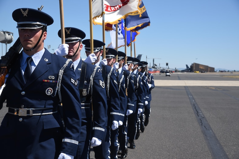 Fairchild Air Force Base Honor Guard members march down the flightline during Fairchild Air Force Base's SkyFest 2017 Air Show and Open House July 30, 2017, at FAFB, Washington. The Honor Guard presented the colors during SkyFest's opening remarks. Fairchild HG Airmen are responsible for providing military funeral honors for deceased Air Force members and provide colors details for various events. (U.S. Air Force photo/Senior Airman Nick J. Daniello)