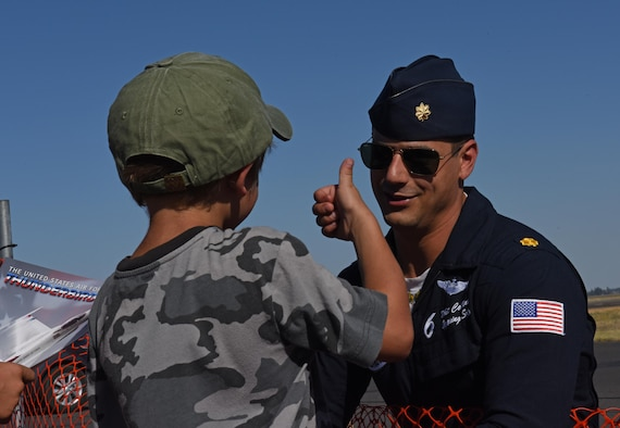 Maj. Whit Collins, solo pilot for the U.S. Air Force Thunderbirds, talks to air show guests during the 2017 Skyfest Air Show and Open House July 29, 2017, at Fairchild Air Force Base, Washington. Skyfest gives the local and regional community the opportunity to view Airmen and Air Force resources. This is Collins' first season with the team, flying jet number six. (U.S. Air Force photo/Airman 1st Class Jesenia Landaverde)
