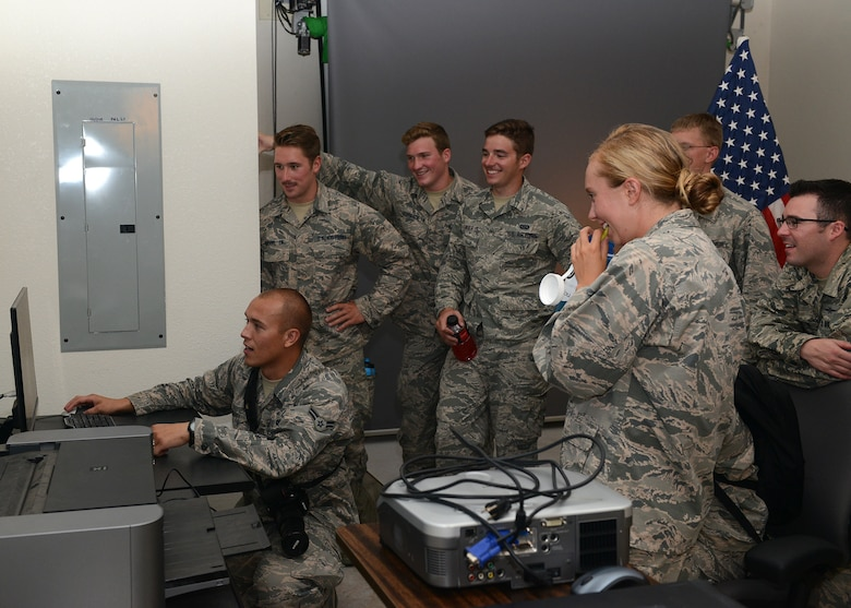 Airman 1st Class Caleb Worpel, 56th Fighter Wing photojournalist, shows the U.S. Air Force Academy cadets the studio editing process during their tour July 31, 2017 at Luke Air Force Base, Ariz. The purpose of the tour was to allow the cadets to shadow officers and enlisted and increase their understanding of what it will be like as a junior officer in the United States Air Force. (U.S. Air Force photo by Senior Airman Devante Williams)