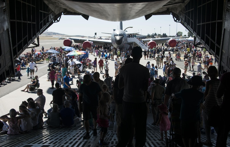 Service members and members from the local community walk off a C-5 Galaxy during SkyFest 2017 Air Show and Open House at Fairchild Air Force Base, Washington, July 29, 2017. SkyFest is Fairchild's air show and open house to give the local and regional community the opportunity to meet Airmen and learn about the Air Force mission. (U.S. Air Force photo/Senior Airman Janelle Patiño)