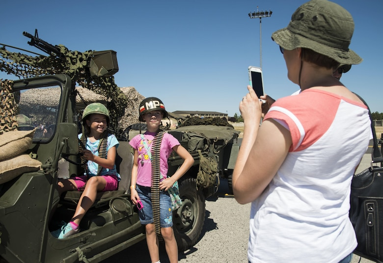 Service members and members from the local community take photos with static displays during the SkyFest 2017 Air Show and Open House at Fairchild Air Force Base, Washington, July 29, 2017. SkyFest was an opportunity to give the local and regional community a chance to view Airmen and our resources. (U.S. Air Force photo/Senior Airman Patiño)