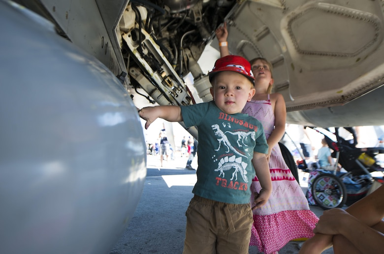 A child touches an aircraft during SkyFest 2017 Air Show and Open House at Fairchild Air Force Base, Washington, July 30, 2017. SkyFest was hosted to thank the local and regional community for their support and give them the opportunity to meet Airmen and learn about the Air Force mission. (U.S. Air Force photo/Senior Airman Janelle Patiño)
