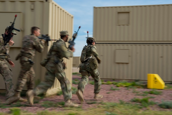 Defenders from Minot Air Force Base's 791st Missile Security Forces Squadron, sprint to cover during an urban improvised explosive device course at Camp Guernsey, Wyo., July 19, 2017. Defenders are placed in multiple scenarios to include search and rescue and capturing enemy held positions. (U.S. Air Force photo by Staff Sgt. Christopher Ruano)
