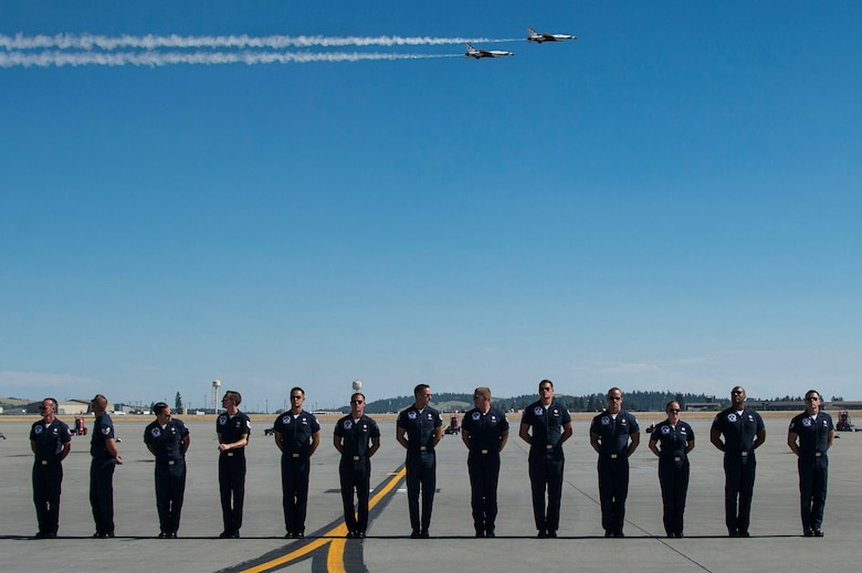 "Members of the U.S. Air Force Aerial Demonstration Squadron ""Thunderbirds"" stand by as the Thunderbirds fly in formation during SkyFest 2017 Air Show and Open House at Fairchild Air Force Base, Washington, July 28, 2017. SkyFest hosted more than 15 types of aircraft and static displays and more than 10 flying performers. (U.S. Air Force photo/Senior Airman Janelle Patiño)"