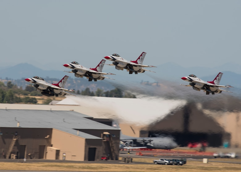 Four F-16 Fighting Falcons from the Thunderbirds aerial demonstration team takeoff in formation as part of their performance at the Skyfest 2017 air show and open house July 30, 2017, at Fairchild Air Force Base, Washington. The Thunderbirds are assigned to the 57th Wing and are based at Nellis Air Force Base, Nevada. (U.S. Air Force photo / Airman 1st Class Ryan Lackey)