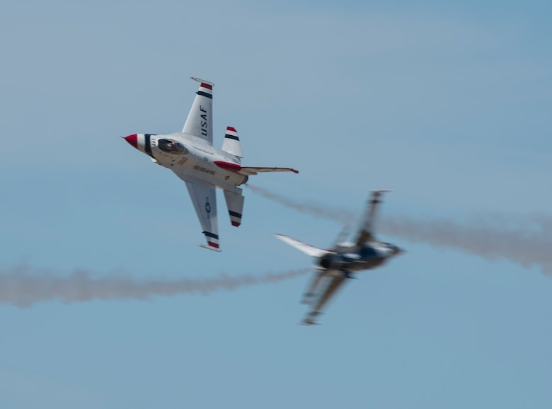 Two F-16 Fighting Falcons from the Thunderbirds aerial demonstration team perform a close, high-speed pass at the Skyfest 2017 air show and open house July 30, 2017, at Fairchild Air Force Base, Washington. Only the top U.S. Air Force pilots are selected to perform for the Thunderbirds, but they still train continuously to perfect their craft while serving with the Thunderbirds. (U.S. Air Force photo / Airman 1st Class Ryan Lackey)