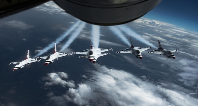 The U.S. Air Force Aerial Demonstration Squadron, the Thunderbirds, fly behind a Team Fairchild KC-135 Stratotanker on their way to the Skyfest 2017 Air Show and Open House July 27, 2017, at Fairchild Air Force Base, Washington.  The 3,600th Air Demonstration Unit was first activated in 1953 at Luke AFB, Arizona, and later adopted the name Thunderbirds. (U.S. Air Force photo/ Senior Airman Sean Campbell)
