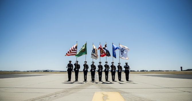The Fairchild Air Force Base Honor Guard presents opening colors at Skyfest 2017 Air Show and Open House July 28, 2017, at Fairchild Air Force Base, Washington. Fairchild's honor guardsmen perform numerous types of ceremonies, to include two-man and six-man flag folding sequences, colors presentation, colors posting and marching in parades. (U.S. Air Force photo/ Senior Airman Sean Campbell)