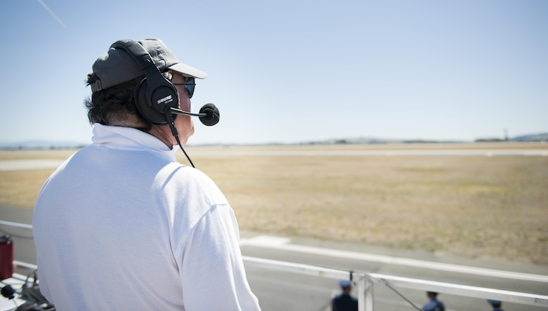 Mr. Mike Berriochoa, announcer for Skyfest 2017 Air Show and Open House , surveys the flightline July 30, 2017, at Fairchild Air Force Base, Washington. Berriochoa has been a member of the International Council of Air Shows since 1983. (U.S. Air Force photo/ Senior Airman Sean Campbell)
