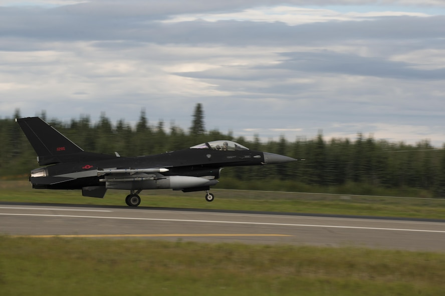 A U.S. Air Force F-16 Fighting Falcon aircraft assigned to the 18th Aggressor Squadron, takes off during RED FLAG-Alaska (RF-A) 17-3, July 31, 2017, at Eielson Air Force Base, Alaska. RF-A provides an optimal training environment in the Indo-Asia-Pacific Region and focuses on improving ground, space, and cyberspace combat readiness and interoperability for U.S. and international forces. (U.S. Air Force photo by Airman 1st Class Isaac Johnson)