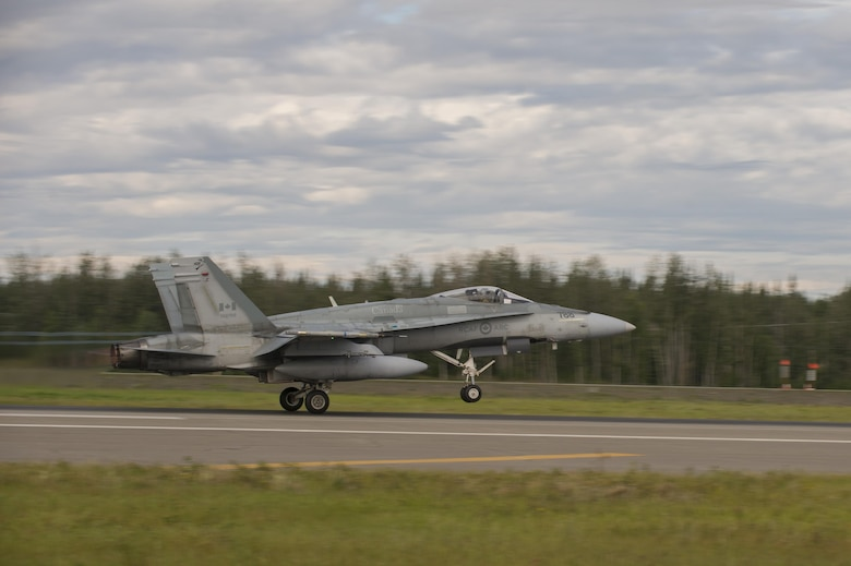 A Royal Canadian Air Force CF-18 Hornet fighter aircraft assigned to the 425th Tactical Fighter Squadron, Canadian Forces Base Bagotville, Canada, takes off during FLAG-Alaska (RF-A) 17-3, July 31, 2017, at Eielson Air Force Base, Alaska. RF-A provides an optimal training environment in the Indo-Asia Pacific Region and focuses on improving ground, space, and cyberspace combat readiness and interoperability for U.S. and international forces. (U.S. Air Force photo by Airman 1st Class Isaac Johnson)