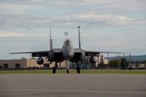 A U.S. Air Force F-15 Strike Eagle fighter aircraft, assigned to the 391st Fighter Squadron, Mountain Home Air Force Base (AFB), Idaho, prepares to take off during FLAG-Alaska (RF-A) 17-3, July 31, 2017, at Eielson AFB, Alaska. RF-A provides an optimal training environment in the Indo-Asia Pacific Region and focuses on improving ground, space, and cyberspace combat readiness and interoperability for U.S. and international forces. (U.S. Air Force photo by Airman 1st Class Isaac Johnson)
