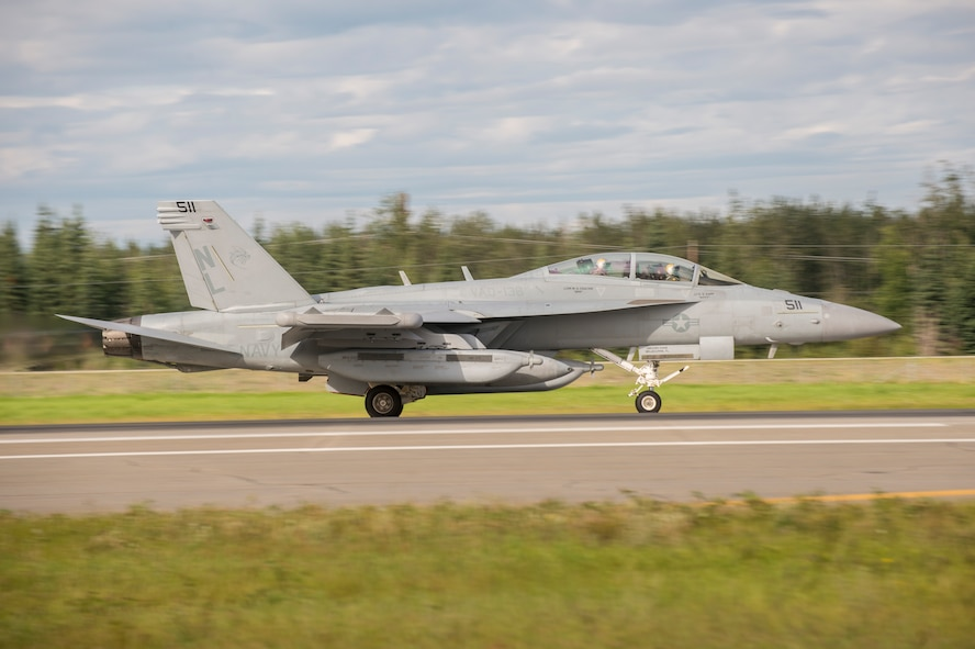 A U.S. Navy EA-18G Growler electronic warfare aircraft assigned to Electronic Attack Squadron 138, Naval Air Station Whidbey Island, Wash., takes off during FLAG-Alaska (RF-A) 17-3, July 31, 2017, at Eielson Air Force Base, Alaska. RF-A provides an optimal training environment in the Indo-Asia Pacific Region and focuses on improving ground, space, and cyberspace combat readiness and interoperability for U.S. and international forces. (U.S. Air Force photo by Airman 1st Class Isaac Johnson)