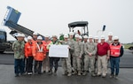 U.S. Air Force Col. R. Scott Jobe, the 35th Fighter Wing commander, pauses for a photo with construction site leaders at Misawa Air Base, Japan, May 25, 2017. Several shops came together to revitalize the airfield. The 35th Civil Engineer Squadron worked with Japanese contractors to reconstruct the airfield, allowing the enhancement of future operations while saving Air Force money. (U.S. Air Force photo by Staff Sgt. Melanie Hutto)