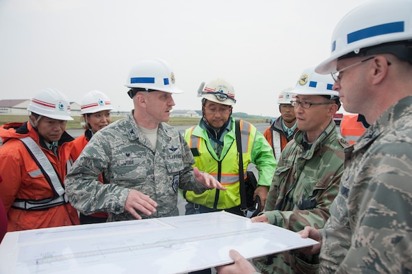 U.S. Air Force Col. R. Scott Jobe, the 35th Fighter Wing commander, discusses construction plans with site leads at Misawa Air Base, Japan, May 25, 2017. The squadron reconstructed a large portion of the runway to further enhance mission quality and ensure the strategic power projection platform that is Misawa Air Base. (U.S. Air Force photo by Staff Sgt. Melanie Hutto)