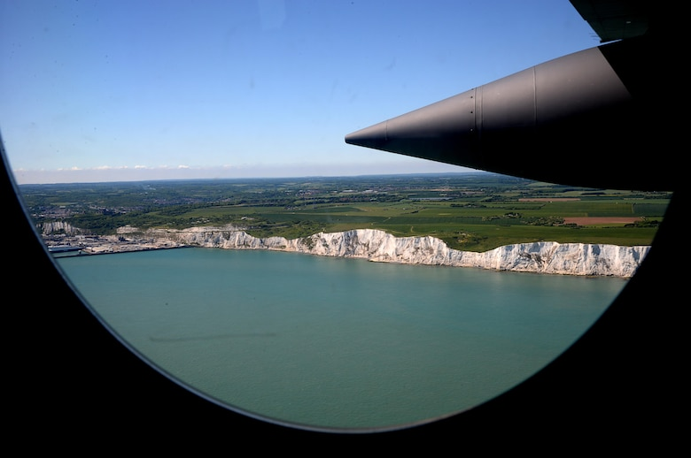 Spouses view the White Cliffs of Dover, England, from the window and ramp of an MC-130J Commando II, May 25, 2017, during an orientation flight offered during the 352d Special Operations Wing Spouses Appreciation Day on RAF Mildenhall, England. The orientation flights were provided to give spouses a greater understanding of the mission their Airmen supports. (U.S. Air Force photo by Senior Airman Justine Rho)