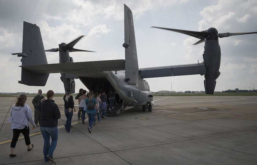 352d Special Operations Wing spouses board a CV-22 Osprey for an orientation flight May 25, 2017, at Spouses Appreciation Day on RAF Mildenhall, England. The flight flew over Framlingham Castle and other areas of East Anglia. The orientation flights were provided to give spouses a greater understanding of the mission their Airmen supports. (Courtesy photo by Senior Airman Nicholas Lord)