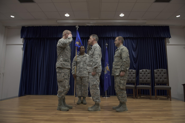 Col. John Walker, 39th Air Base Wing commander, and Col. Thomas A. Bacon, outgoing 39th Medical Group commander, exchange salutes during the 39th MDG change of command ceremony  May 27, 2017, at Incirlik Air Base, Turkey. (U.S. Air Force photo by Airman 1st Class Kristan Campbell)