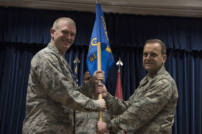 Col. John Walker, 39th Air Base Wing commander, passes the 39th Medical Group guideon to Col. Vito Smyth, 39th MDG commander, during a change of command ceremony May 27, 2017, at Incirlik Air Base, Turkey. (U.S. Air Force photo by Airman 1st Class Kristan Campbell)