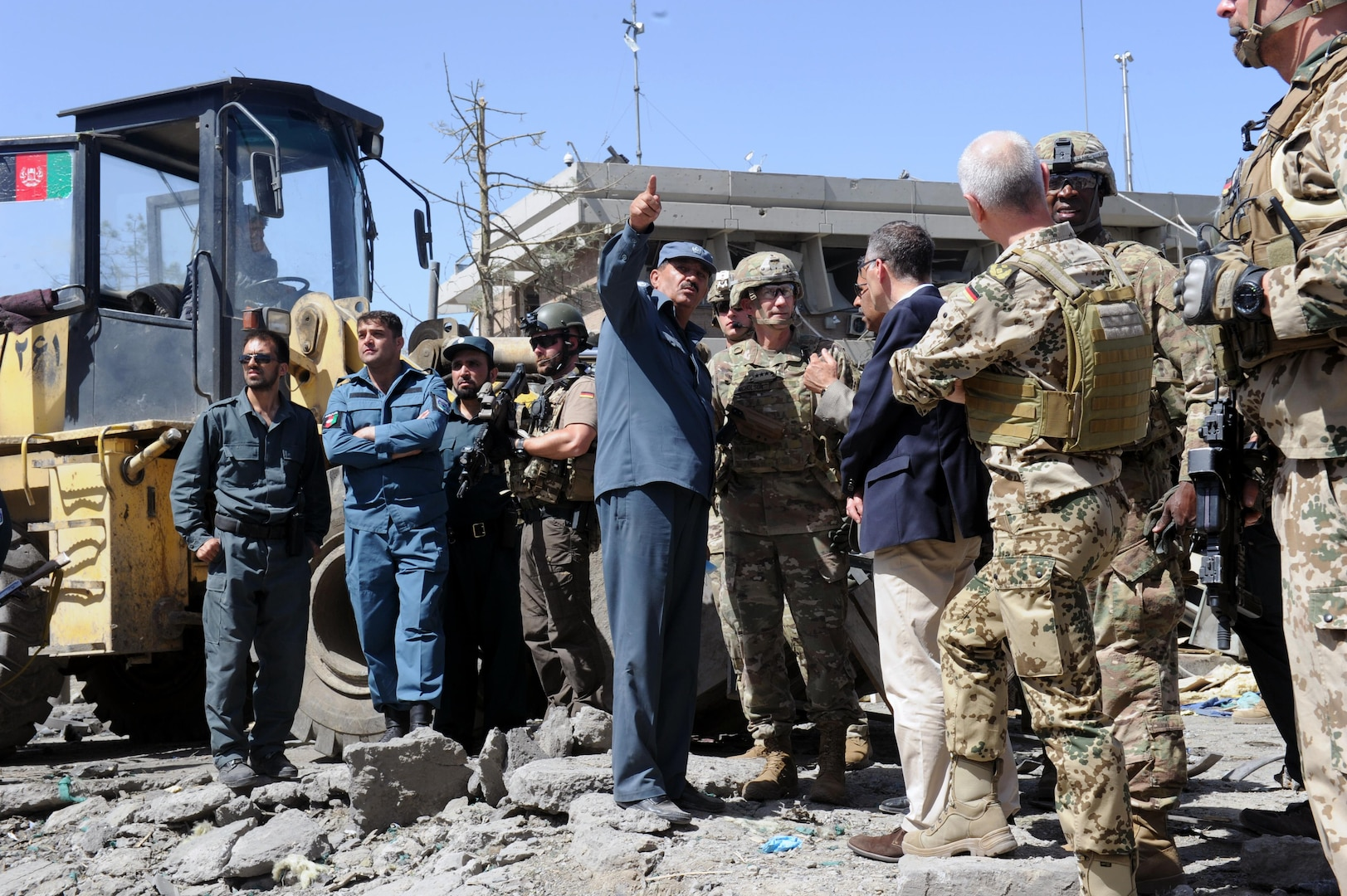 KABUL, Afghanistan (May 31, 2017) — General John Nicholson, Resolute Support commander, RS Chief of Staff Lieutenant General Jurgen Weigt, and RS Command Sergeant Major David M. Clark visit the blast site after the deadly attack that occurred here today to survey the damage and support emergency. A vehicle-borne improvised explosive device was detonated near Zambaq Square outside the Green Zone, near diplomatic and government facilities. (U.S. Navy photo by Lt. j.g. Egdanis Torres Sierra, Resolute Support Public Affairs – Afghanistan)