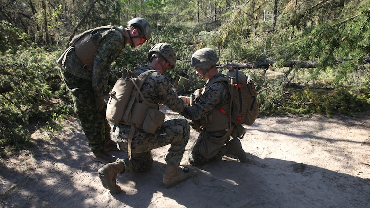 COLD LAKE, AB, CANADA – Marines with Engineer Company, Detachment Bravo, Marine Wing Support Squadron 473, 4th Marine Aircraft Wing, Marine Forces Reserve, measure detonating cord to create a field expedient Bangalore torpedo, May 28, 2017. Marines trained in obstacle breaching, clearing an abatis crated by Canadian Armed Forces members as part of exercise Maple Flag 50.