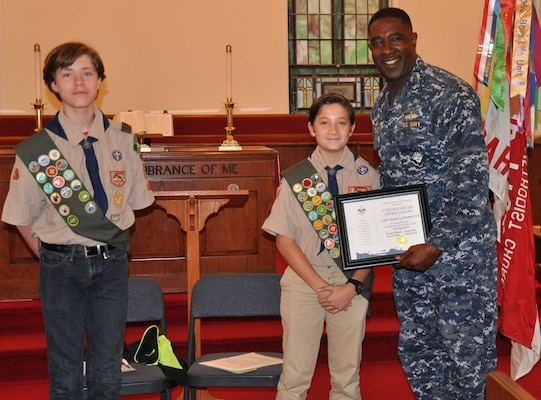 DAHLGREN, Va. (May 24, 2017) - Boy Scouts Drew Warder and Lucas Umberger present Naval Surface Warfare Center Dahlgren Division Commanding Officer Capt. Godfrey 'Gus' Weekes with a Certificate of Appreciation after his speech to Boy Scout Troop 1404. Weekes spoke to the troop about his Navy career and world-wide travels, citing examples of the importance of being prepared and looking out for shipmates, fellow scouts, and teammates in any situation, to include hiking and camping expeditions.