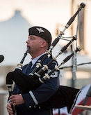 Tech. Sgt. Adam Tianello, U.S. Air Force Band's Celtic Aire ensemble bagpiper, plays a bagpipe during a Memorial Day weekend concert at the National Harbor in Fort Washington, Md., May 27, 2017. Audience members had the opportunity to sing along to traditional and folk music, while watching the Air Force's only official bagpiper perform. (U.S. Air Force photo by Airman 1st Class Valentina Lopez)