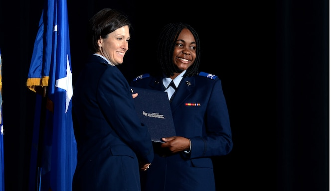 Col. Jacqueline Breeden, commander of the U.S. Air Force Academy Preparatory School, gives a prep school diploma to a graduating cadet-candidate May 18, 2017, at the Community Center Theater. In all, 194 cadet-candidates graduated and 186 cadet-candidates received appointments to the Academy. (U.S. Air Force photo/Jason Gutierrez)