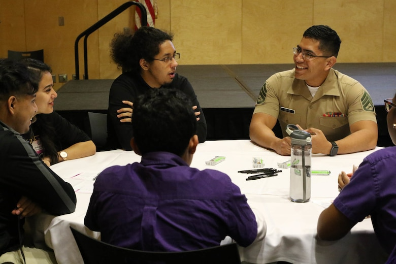 Staff Sergeant Alberto Ortiz, a recruiter with Recruiting Sub-Station Houma, interacts with high school students during the Latinos on the Fast Track Program's Body, Mind and Spirit Seminar held at Tulane University in New Orleans on April 24, 2017. The seminar comprised of more than 160 high school juniors and seniors from the New Orleans area. (U.S. Marine Corps photo by Staff Sgt. Rubin J. Tan/Released)