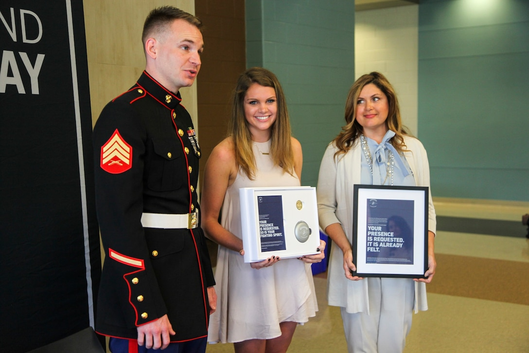 U.S. Marine Sgt. Roderick Evans presents Natasha Kusibab and her mentor, Belinda Kusibab, an invitation to attend the 2017 Battles Won Academy at Brentwood High School, Brentwood, Tennessee, on May 9, 2017. The Battles Won Academy taps into the irreducible essence of the Marine Corps, which is the fighting spirit of the Marine. The essence of the Marines individually and collectively is the willingness to engage and the determination to defeat an opposing force – whether personal or on behalf of our nation and its communities. (U.S. Marine Corps photo by Sgt. Mandaline Hatch)