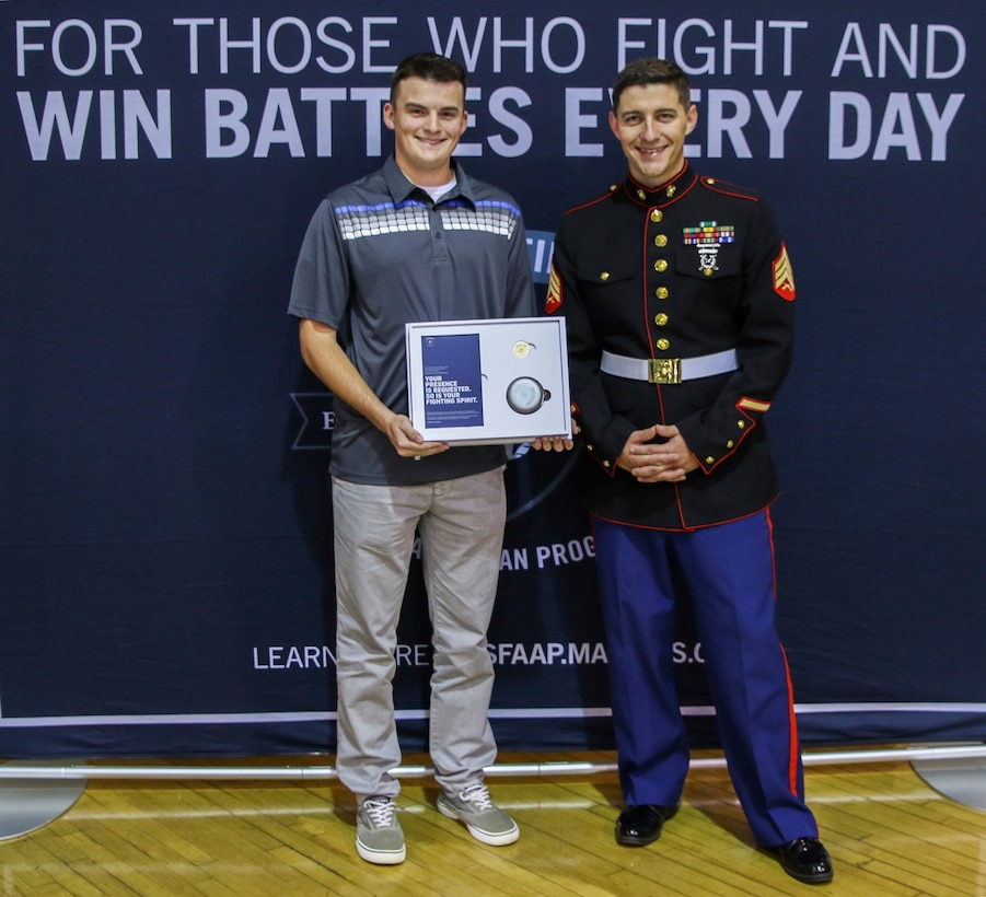 U.S. Marine Sgt. Sean Silverman presents Haden Blair an invitation to attend the 2017 Battles Won Academy at McMinn Central High School, Englewood, Tennessee, on May 19, 2017. The Battles Won Academy taps into the irreducible essence of the Marine Corps, which is the fighting spirit of the Marine. The essence of the Marines individually and collectively is the willingness to engage and the determination to defeat an opposing force – whether personal or on behalf of our nation and its communities. (U.S. Marine Corps photo by Sgt. Mandaline Hatch)