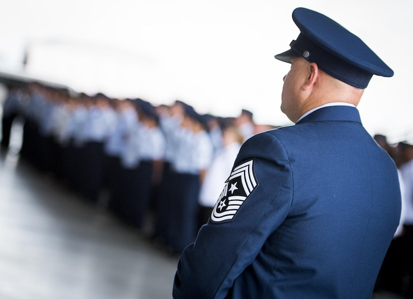 Chief Master Sgt. Zaki Mazid, 96th Test Wing command chief, stands by his Airmen during the 96th Test Wing change of command ceremony at Eglin Air Force Base, Fla., May 31.  Brig. Gen. Christopher Azzano relinquished command to Brig. Gen. Evan Dertien.  The command position is Dertien's third assignment to Team Eglin.  (U.S. Air Force photo/Samuel King Jr.)