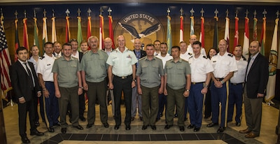 Tampa, Fla. - U.S. Central Command representatives and military officers from the Republic of Tajikistan Ministry of Defense pose for a group photo during the 2017 combined U.S.-Tajikistan consultative staff talks (CST). The talks are an annual event held in Tampa, Florida designed to review the security cooperation progress of the previous year's military-to-military events and finalize the coming years military-to-military planning between the two partners. (Photo by Tom Gagnier)