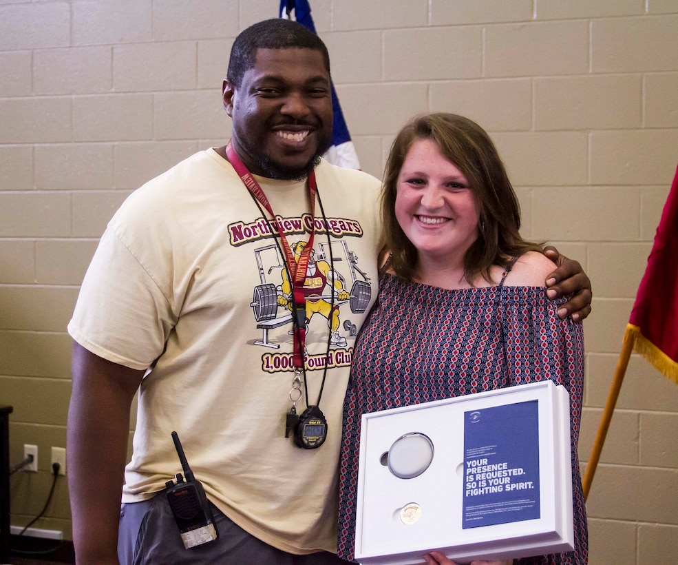 Gracyn LaSueur (right) poses with her strength and conditioning coach, Derrick Bumpers (left) after being present with the Semper Fidelis All-American Award at Northview High School, May 18, 2017. LaSueur is exactly what the Marine Corps is looking for when it comes to a Semper Fidelis All-American. She has turned her obstacles into victories by overcoming odds set against her at a very early age. She dedicates her success to Coach Bumpers who aided her in her recovery after not only tearing her meniscus, but straining her medial collateral ligament (MCL) as well.  (U.S. Marine Corps photo by Cpl. Krista James/Released)